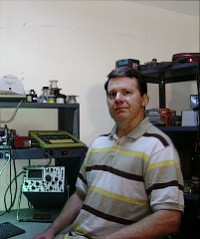 Frank Overstreet sitting at his home lab bench