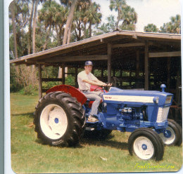 Frank Overstreet sitting on freshly rebuilt Ford 4000 tractor at family farm.