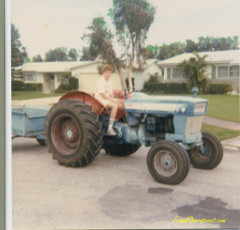 Frank Overstreet's younger brother on Ford 4000 tractor.