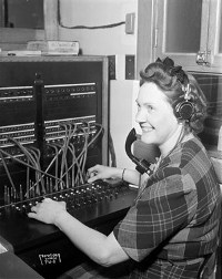 Old fashioned telephone switchboard operator